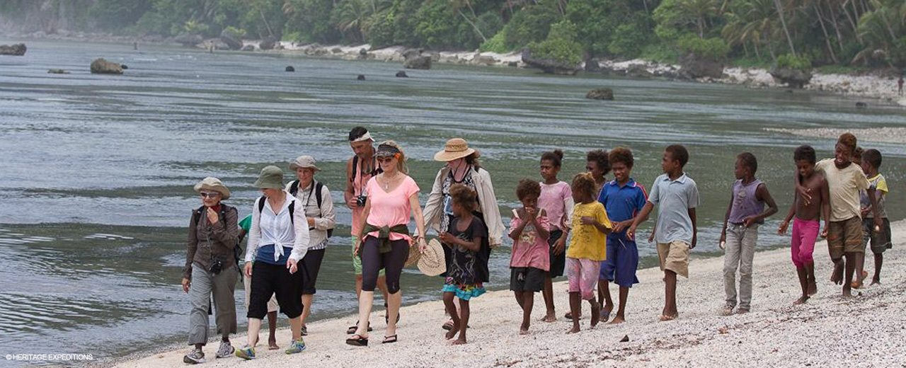 Melanesian beach walk with entourage